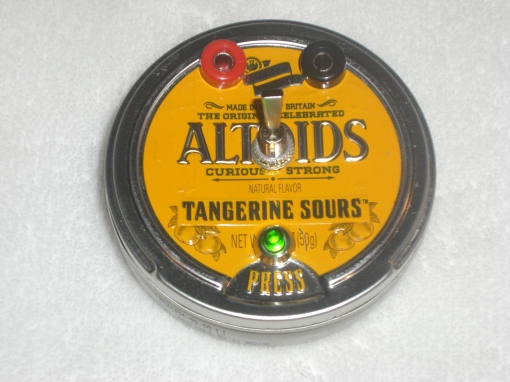 The safety is off and the Altoids tin is armed.